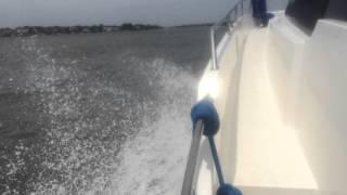 Evinrude G2 outboards repower Trawler Catamaran