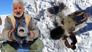 Donan baraj gölünde Eskimo usulü balık avlıyorlar