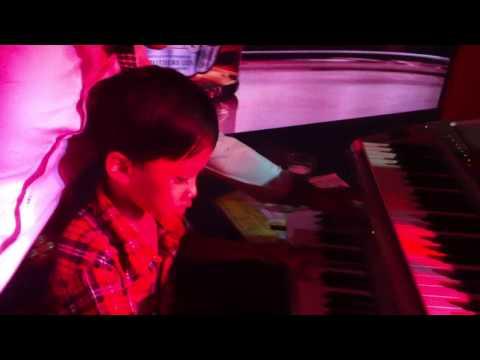 6 year old Cambodian kid, Krang Satha,plays organ at Polo Restaurant.