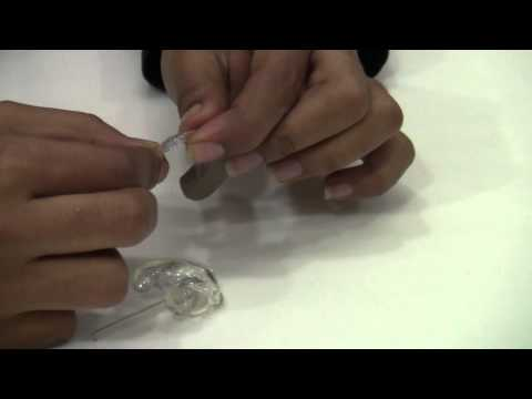 How to put ear tips , moudls , in a Hearing Aid