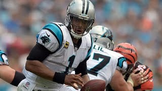 Cam Newton muscles through dogpile to recover his own fumble