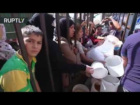 RAW: Starved Aleppo residents line up for badly needed food aid