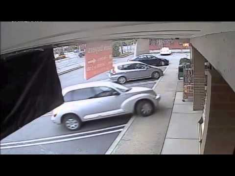 Woman hits car, bookstore display