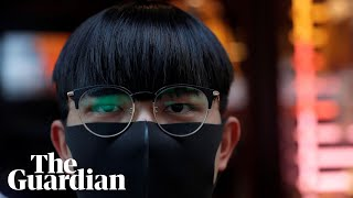 Peaceful protesters form human chains after mask ban in Hong Kong