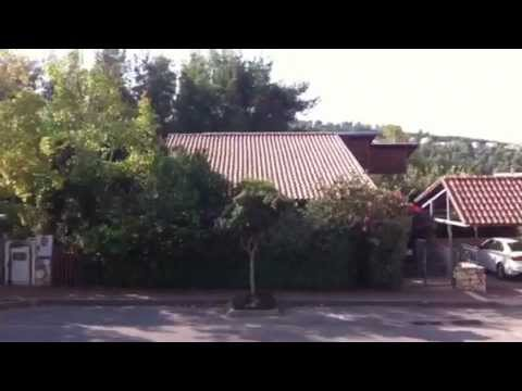 Full Building-Integrated Photovoltaic (BIPV) residential roof and carport 1/2