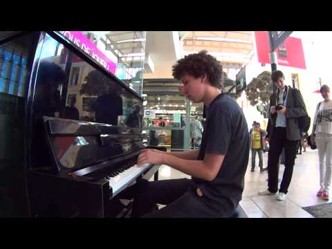 Kid playing piano at Marseille train station