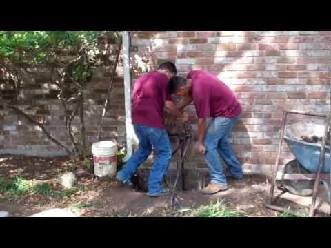 Foundation Repair Houston TX  (713) 668-2110 - Drilling the Bell Bottom Shaft