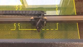 Techsoft LaserCAM A2+ cutting acrylic (perspex) laser cutter running 2D Design V25