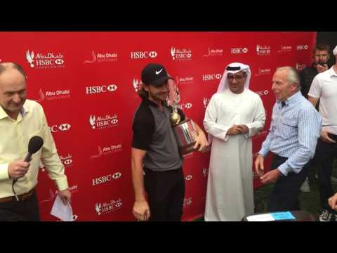Tommy Fleetwood with the 2017 Abu Dhabi HSBC Golf Championship falcon trophy