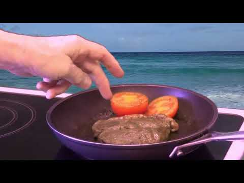 Crazy Chef cooks a steak on the beach in Barbados . Triangulum Galaxy Productions