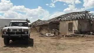 cummins 6bt powered ford crew cab pullin a house down