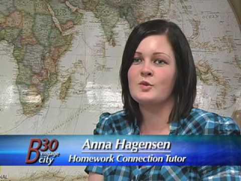 Volunteers Help Students Complete Homework