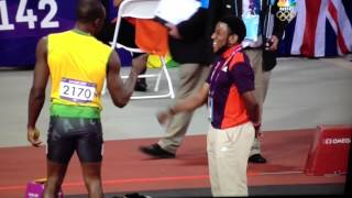 Usain Bolt fist-bumps volunteer