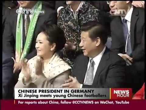 President Xi visits Chinese kid footballers in Germany