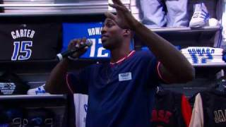 Dwight Howard Works at the Champs Sports Official NBA Shop in Orlando
