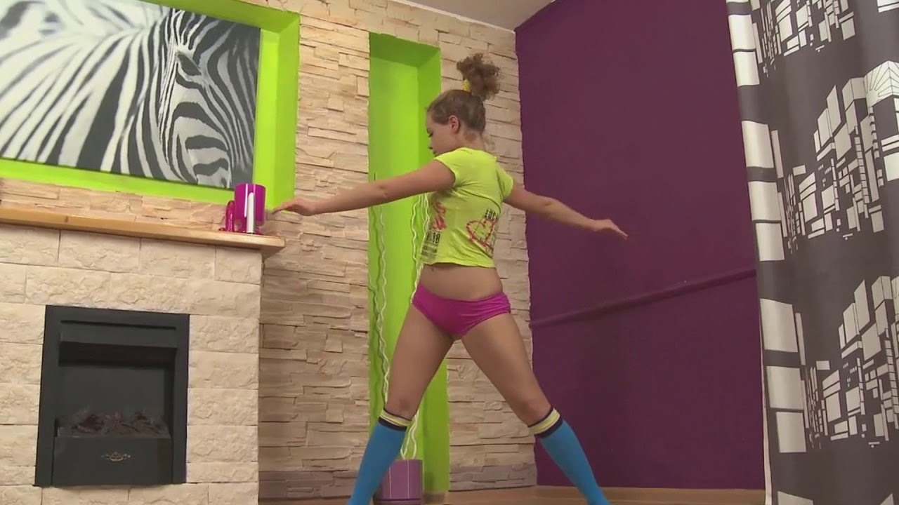 Hot Yoga Girl Cute Sunny Stretching Out for healthy and flexible body