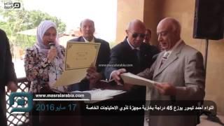 مصر العربية | اللواء أحمد تيمور يوزع 45 دراجة بخارية مجهزة لذوي الاحتياجات الخاصة