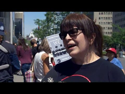 Rally for $15 minimum wage held in Toronto