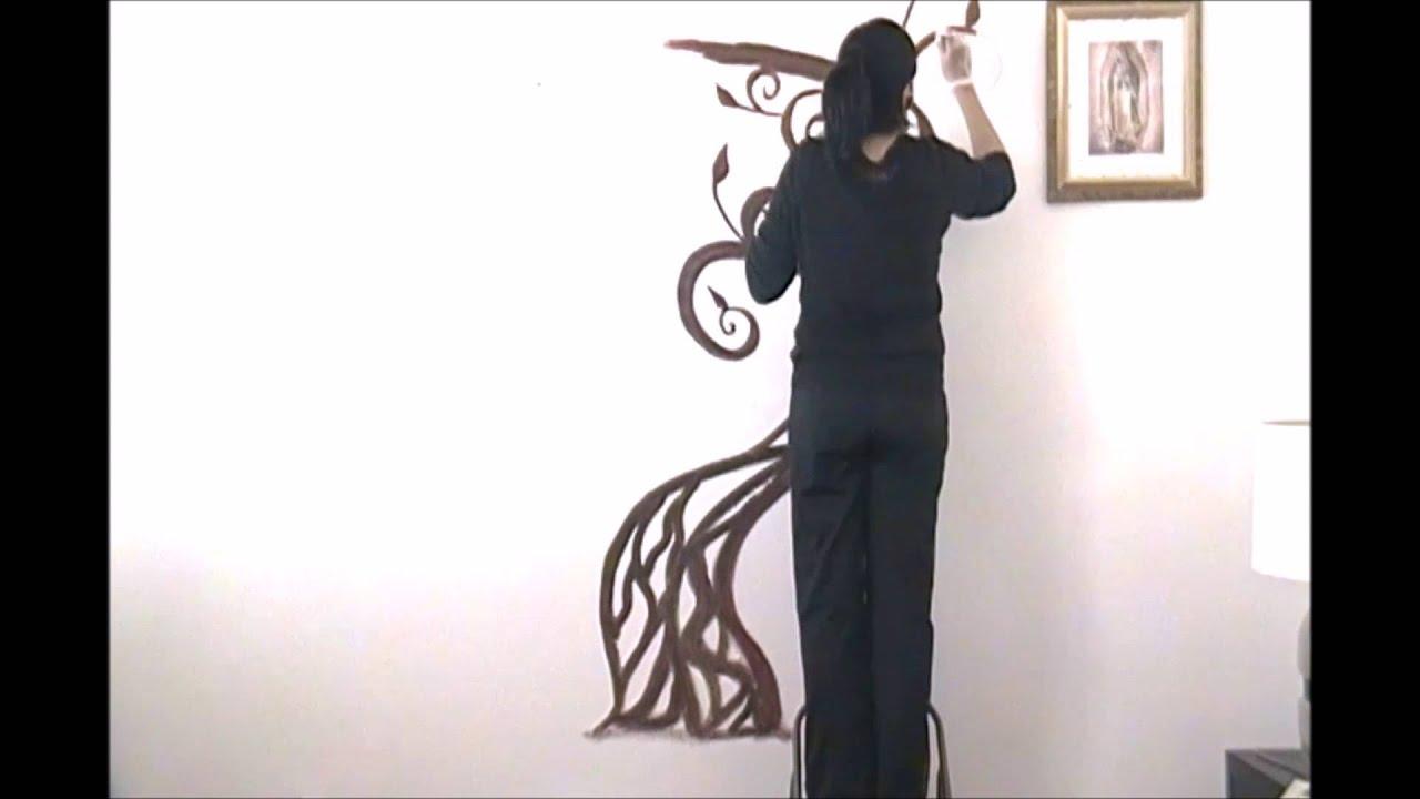 C mo hacer un mural para fotos en la pared de tu sala for Murales en 3d para salas