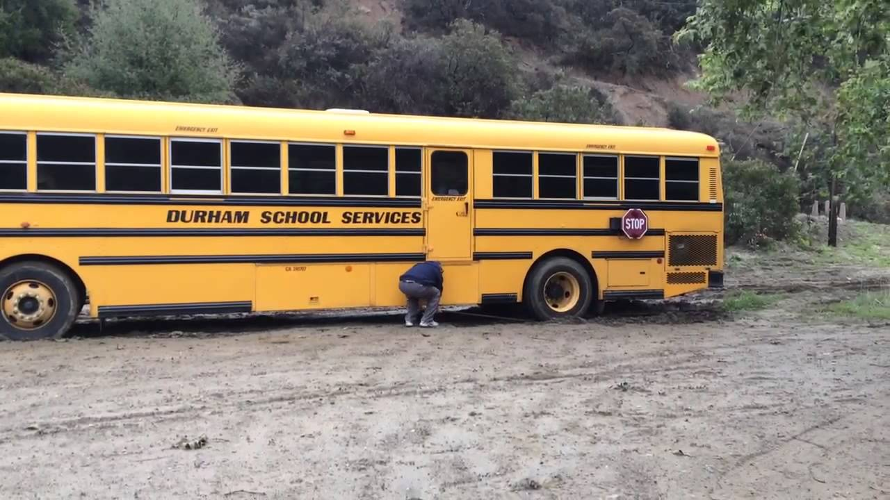 Image result for bus stuck in mud