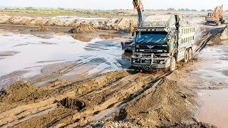 UD Nissan truck dumper crossing huge muds with full excalator .May 13, 2019