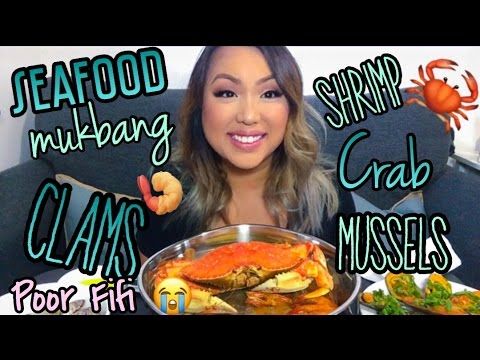 SEAFOOD MUKBANG with TRANG: Crab, clams, mussels, and shrimp.