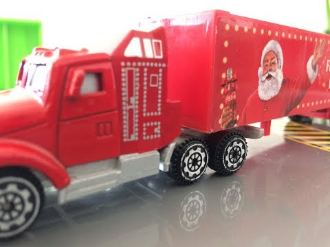 theo-playing-with-xmas-coca-cola-truck