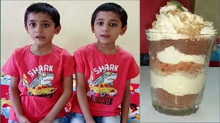 Cooking without fire recipe. Twins prepare Carrot Halwa with butterscotch cream  dessert