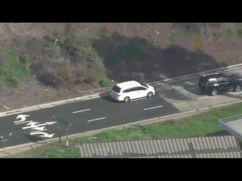 Police chase possibly armed suspect through San Fernando Val