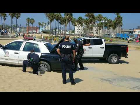 Part 2 LAPD police car runs over a woman in the sand sunbathing at venice beach
