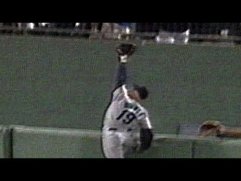 Jay Buhner leaps and TUMBLES over the fence to rob a home run