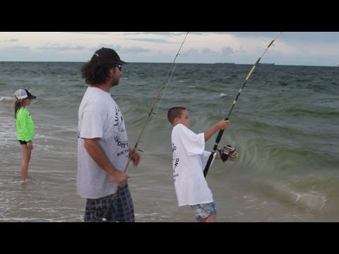 Awesome Beach Fishing - Kid Catches Big Fish During Happy Bait Mullet Run