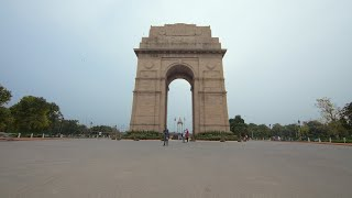 Low angle timelapse shot of people's activity at India gate in New Delhi on a rainy day