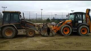 Cat vs. JCB