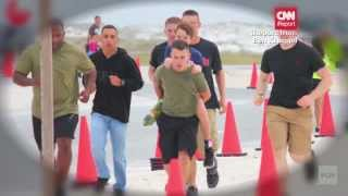 Marines help a young boy finish a triathlon!