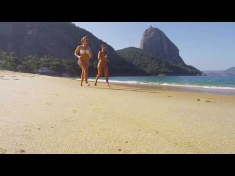 Slow motion of women jogging on a Rio beach.