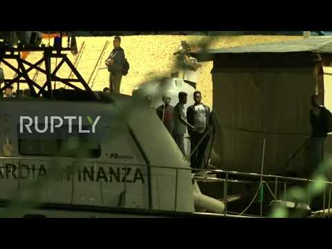 Italy: Migrants onboard second rescue ship set foot on land in Lampedusa