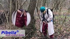 Grandma pees in the woods with urinary device Pibella