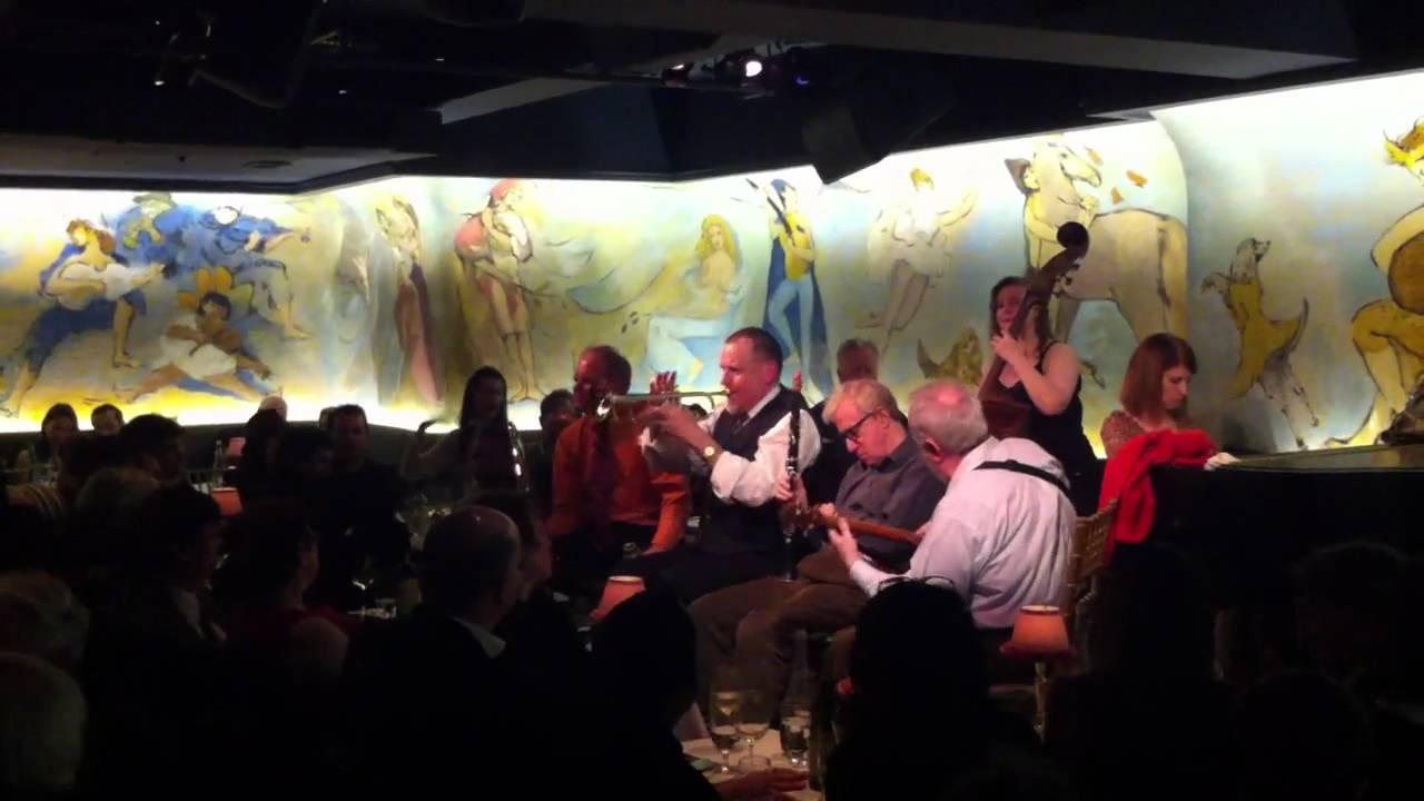 Woody Allen performing...