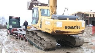 Driving The Broken Down Komatsu Excavator On To The Trailer