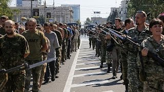 Video: Captured Ukrainian soldiers march through streets of Donetsk