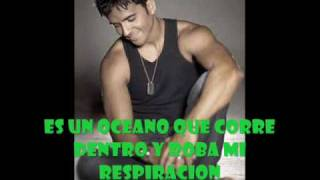 Watch music video: Luis Fonsi - Extraño Sentimiento