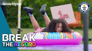 Watch Us Try To Break The Record For Distance Traveled On A Plastic Water Slide!