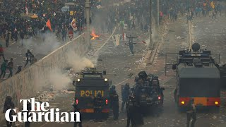 Indonesian police fire water canon during rally against new penal code