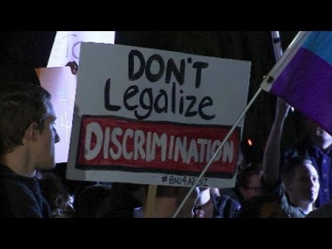 Caller: I'm Bi-Sexual and Agree with the Arizona Law