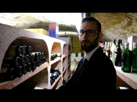 Bernard presents the wine cellar of restaurant La Distillerie
