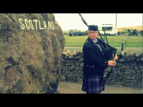 England/Scotland Border complete with Bagpiper!