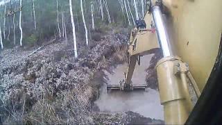 Чистим и копаем осушительный канал.