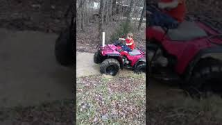Lil Roy learning how to mud ride on the ole Honda 300 4x4