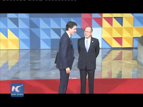 Canada's Trudeau shaking hands with Philippine president